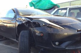 Toyota wrecked car due to texting accident.